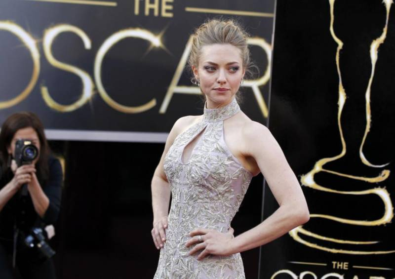 """Actress Amanda Seyfried, from """"Les Miserables,"""" arrives at the 85th Academy Awards in Hollywood"""
